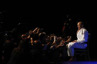 Georges St. Pierre answers questions during the publicity workout for UFC 167 Wednesday, Nov. 13, 2013 at the MGM Grand.