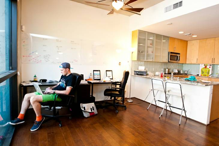 While his team is working in the field, CEO Austin Hackett concentrates on his work in their office space at CrowdHall located at 353 East Bonneville Aveue, Suite 752, in Las Vegas Monday, November 11, 2013.