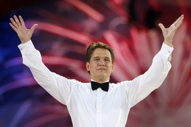 Boston Pops conductor Keith Lockhart takes a bow during rehearsal for the orchestra's Fourth of July concert at the Hatch Shell in Boston on Wednesday, July 3, 2013.