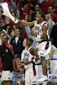 UNLV's Omari Pearson and the UNLV bench celebrate during their double overtime game against New Mexico at the Mountain West tournament in Las Vegas Thursday, March 7, 2002. UNLV defeated New Mexico 120-117.