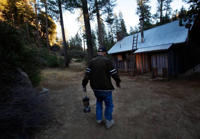 Jack English, 94, walks with a lanter outside his remote cabin in the Ventana Wilderness of California on Nov. 17, 2013.