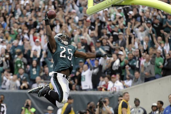 Philadelphia Eagles running back LeSean McCoy celebrates his touchdown during the first half of an NFL football game against the Washington Redskins in Philadelphia on Sunday, Nov. 17, 2013.
