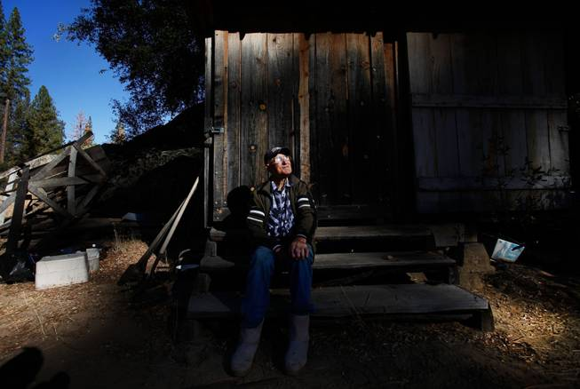 Jack English, 94, sits on the steps to his tool shed at his remote cabin in the Ventana Wilderness of California on Nov. 17, 2013.