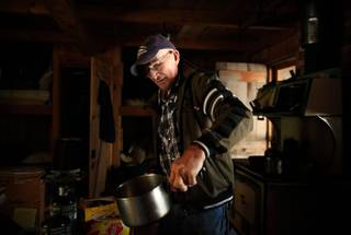 Jack English, 94, boils water for tea at his remote cabin in the Ventana Wilderness of California on Nov. 17, 2013.