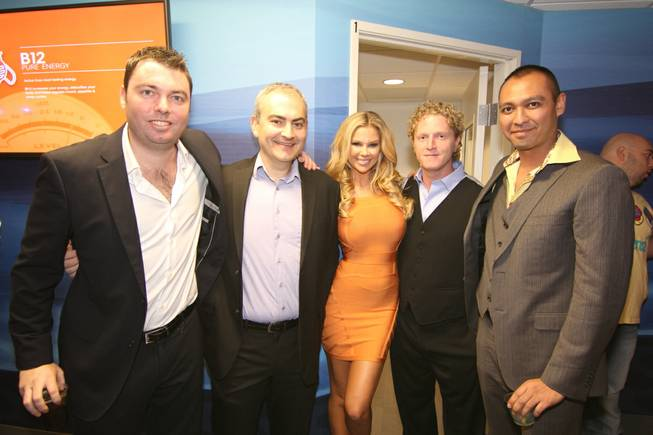 Jessa Hinton is flanked by Reviv owners German Kaupert, Dr. Raanan Pokroy, Dr. Andrew Garff and Dr. Johnny Parvani at MGM Grand.