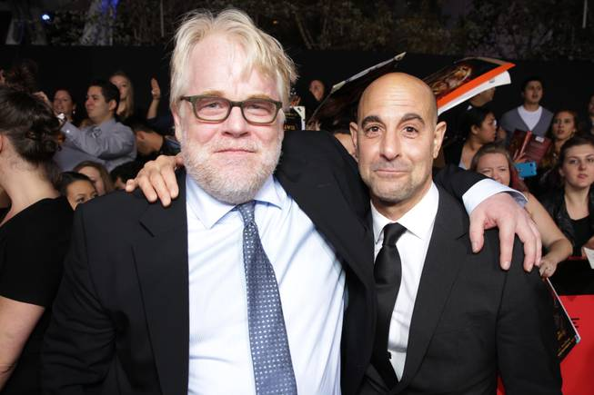 Philip Seymour Hoffman and Stanley Tucci seen at Lionsgate's 'The Hunger Games: Catching Fire' Los Angeles Premiere, on Monday, Nov, 18, 2013, in Los Angeles.