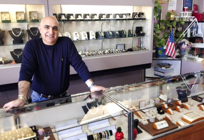 Alex Kassarjian operates the jewelry half of Alexs Shoe and Jewelry Repair, a 10-year-old Las Vegas business, on Nov. 18, 2013.