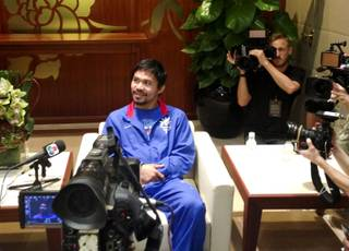 Manny Pacquiao takes a break as he is interviewed after his