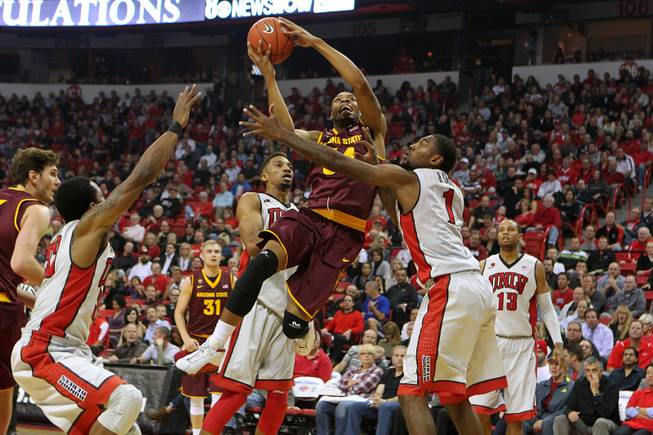 UNLV forward Khem Birch and Roscoe Smith defend Arizona State guard Jermaine Marshall during their game Tuesday, Nov. 19, 2013 at the Thomas & Mack.