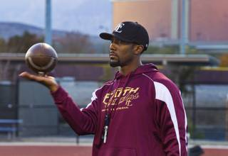 Faith Lutheran football coach Vernon Fox, a former NFL player who is known for his legendary motivational speeches, keeps an eye on his players during practice Tuesday, Nov. 19, 2013.