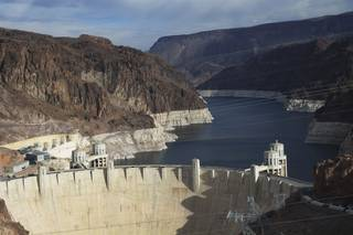 A view of Hoover Dam and Lake Mead shows canyon walls ringed with white mineral deposits indicating the drop in water levels near Boulder City, Nev., Dec. 18, 2013.