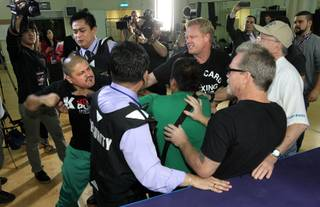 Teams battled and tempers flared at a workout today when the camps of Team Rios and Team Pacquiao crossed paths during training sessions Wednesday at The Venetian Macao Resort, Nov. 19, 2013.