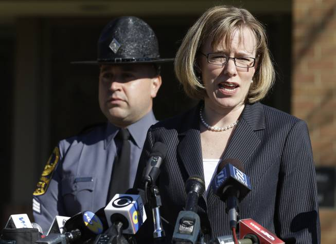 Virginia State Police spokeswoman, Corinne Geller, right, briefs the press during a news conference in Charlottesville, Va., Tuesday, Nov. 19, 2013. Geller confirmed that Virginia State Senator Creigh Deeds was stabbed multiple times and his son was killed at Deeds' home in Bath County, Va., during a Tuesday morning assault.
