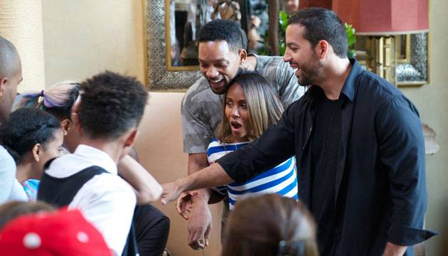 "David Blaine, right, with Will Smith and Jada Pinkett, on Blaine's ABC special ""Real or Magic."""
