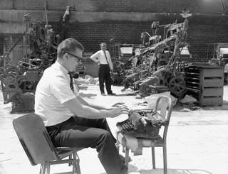 A Sun staffer pretends to use a typewriter in the burned out Las Vegas Sun building at 900 S. Main Street on April 23, 1964.  The building burned down on November 20, 1963.