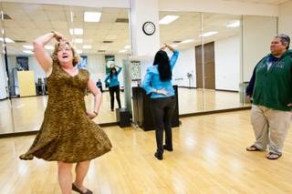 Maureen Vocke, from left, and Lydia Noyola act out a dance scene as Emerson Williams watches from the side while participating in a new acting class for adults at the Charleston Heights Arts Center in Las Vegas November 20, 2013.