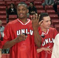 UNLV's Kevin Simmons (left) shows off his 1998 Western Athletic Conference tournament championship ring. Mark Dickel, the point guard on the title team, is at right.