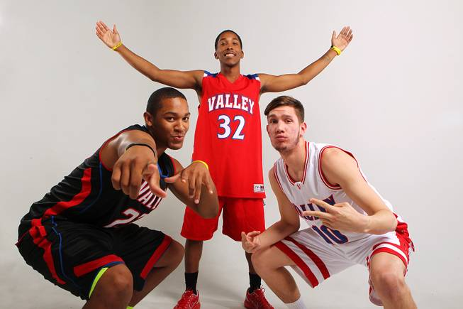 Valley basketball players, from left, Shea Garland, Cam Burton and Spencer Mathis Thursday, Nov. 21, 2013.
