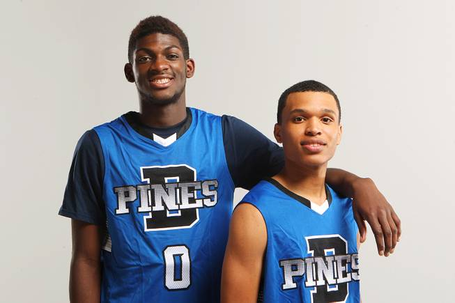 Desert Pines basketball players, from left, Re'Meake Keith and Coby Myles Thursday, Nov. 21, 2013.