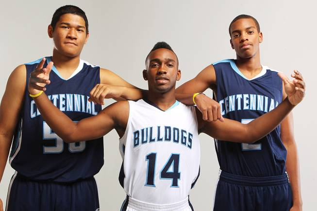Centennial basketball players, from left, Eddie Davis, Khalil Thompson and Troy Brown Thursday, Nov. 21, 2013.