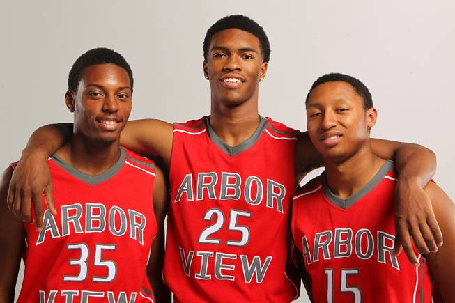 Arbor View basketball players, from left, Terrell Butler, Justin Burks and Charles Porter Thursday, Nov. 21, 2013.