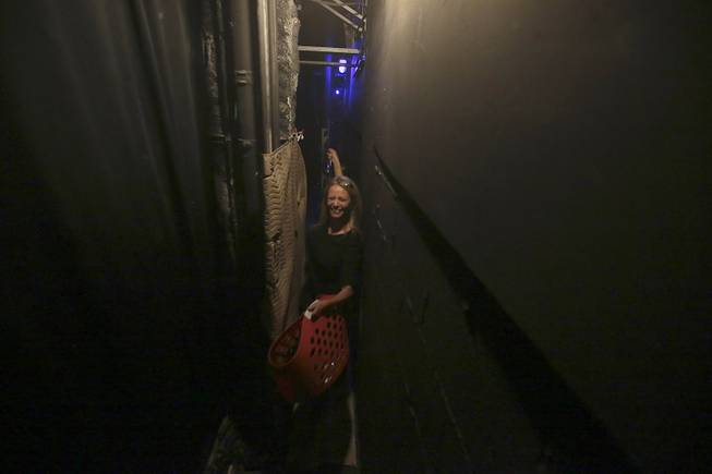 "Squeezing through a tight space behind the stage, show dresser Paula Nyland preps for ""Vegas! The Show"" at the Saxe Theater in Las Vegas."
