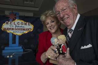 Las Vegas Mayor Carolyn Goodman, left, poses for portrait with predecessor and husband, former Mayor Oscar Goodman, Nov. 21, 2013, with their bobble head dolls.