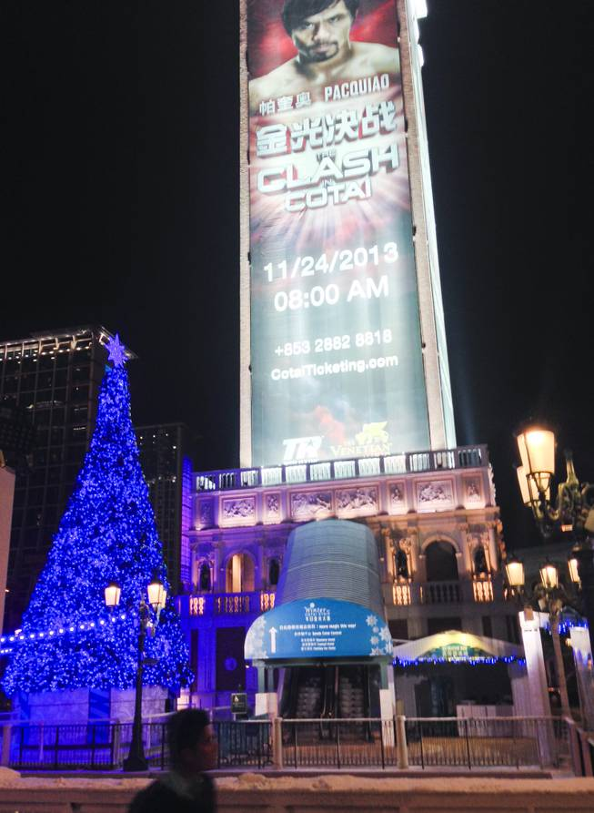 A giant Pacquiao vs Rios fight ad is seen behind the Venetian Macau Christmas tree on display outside the property.