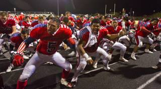 Liberty High School football players during a Samoan Haka dance at their playoff game versus Green Valley on Friday, Nov. 22, 2013.