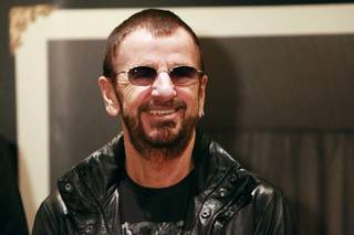 Ringo Starr appears at an event to promote the publication of his book of pictures Saturday, Nov. 23, 2013.