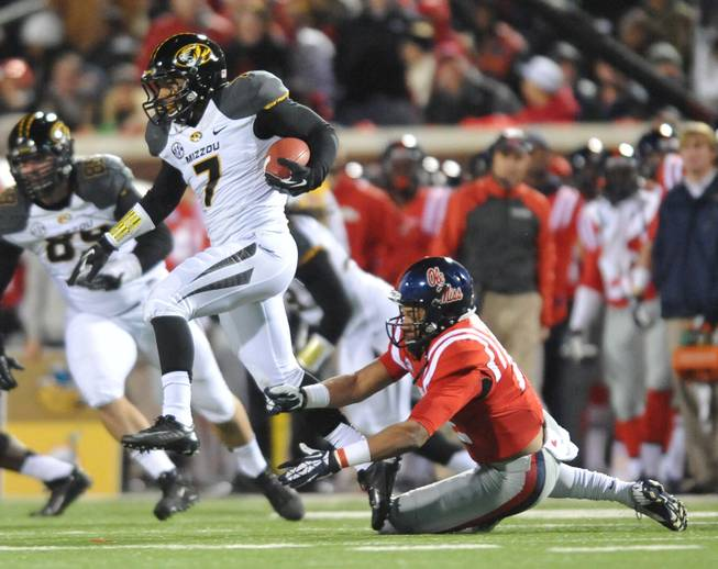 Missouri's Randy Ponder (7) intercepts a pass and runs from Mississippi wide receiver Donte Moncrief (12) at Vaught-Hemingway Stadium in Oxford, Miss. on Saturday, Nov. 23, 2013. Missouri won 24-10.