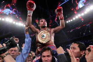 November 24, 2013, Macau, China  ---   Superstar Manny Pacquiao (R) wins a 12-round unanimous decision over Brandon