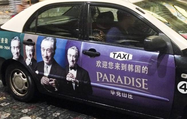 A cab in Macau advertising something with Robert De Niro.