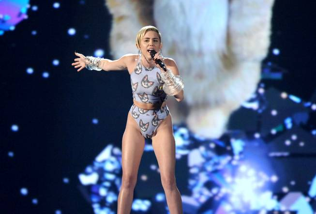 Miley Cyrus performs at the American Music Awards at Nokia Theater L.A. Live on Sunday, Nov. 24, 2013, in Los Angeles.
