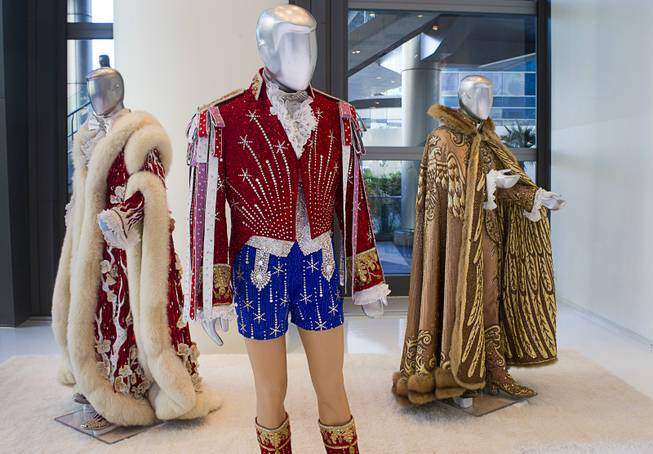 "Costumes worn by Liberace are displayed at ""Too Much of a Good Thing Is Wonderful: Liberace and the Art of Costume"" in the Cosmopolitan Monday, Nov. 25, 2013. The exhibit opened Monday and will run through Jan.1, 2014. Admission is free but any donations will benefit the Liberace Foundations scholarship fund."