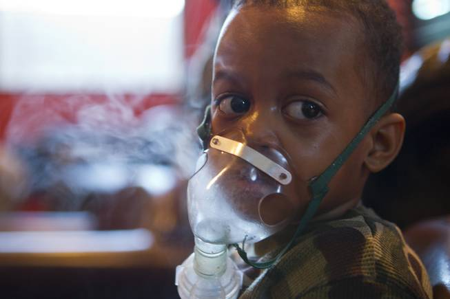 Derrick Derrico, 3, spends time on a vaporizer to stave off a cold as the quintuplets are at a high risk of getting sick on Thursday, Nov. 25, 2013.