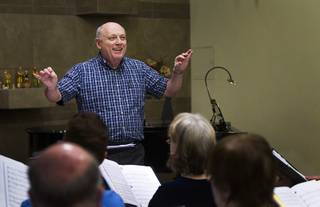Myron Heaton conducts the Myron Heaton Chorale during a rehearsal at Christ the Servant Lutheran Church in Henderson Tuesday, Nov. 26, 2013. The Chorale are scheduled to perform at the church on Dec. 8.