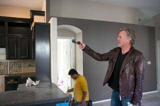 "Scott Yancey, from A&E's ""Flipping Vegas,"" does a walk-through to see the progress of one of their remodeling projects on Tuesday Nov. 26, 2013."
