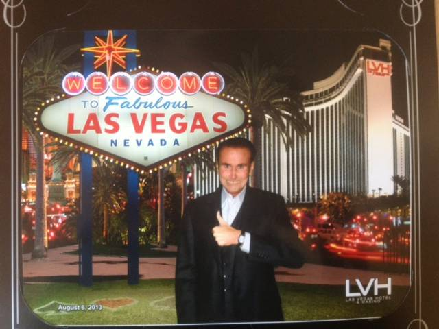 David Atwell shown in front of a Welcome To Fabulous Las Vegas sign display at LVH in August.
