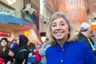 Congresswoman Dina Titus takes part in a ceremony at the Fremont Street Experience welcoming the Festival of Lights, Wednesday Nov. 27, 2013.