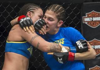 (From left) Raquel Pennington gets in the face of her opponent  Roxanne Modafferi during their women's bantamweight TUF 18 finale bout at the Mandalay Bay Events Center on Saturday, Nov. 30, 2013.