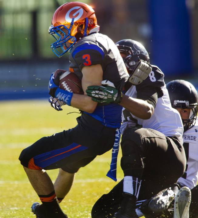 Bishop Gorman's Brandon Gahagan (3) is caught from behind by Palo Verde's Dallas White (8) during their regional championships on Saturday, Nov. 30, 2013.  L.E. Baskow