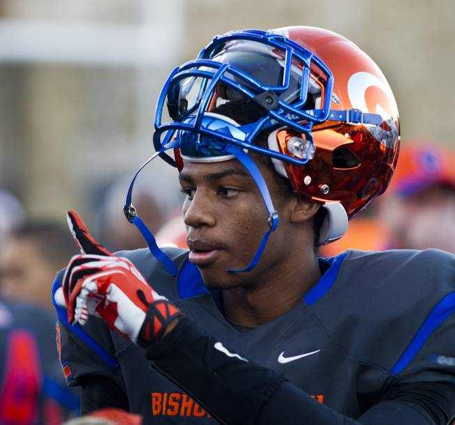 Bishop Gorman QB Randall Cunnigham Jr. (12) signals a teammate during the game versus Palo Verde on Saturday,  Nov. 30, 2013.