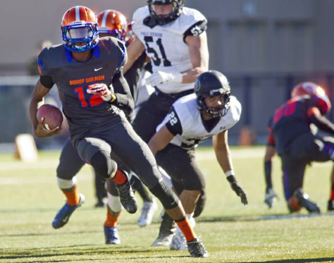 Bishop Gorman QB Randall Cunnigham II breaks loose for his first touchdown of the game against Palo Verde on Saturday, Nov. 30, 2013.