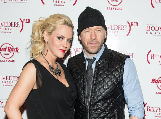 Jenny McCarthy, with boyfriend Donnie Wahlberg, hosts her