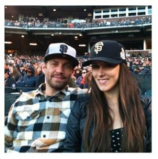 Pual Walker and Aubrianna Atwell at a San Francisco Giants game in April 2013.