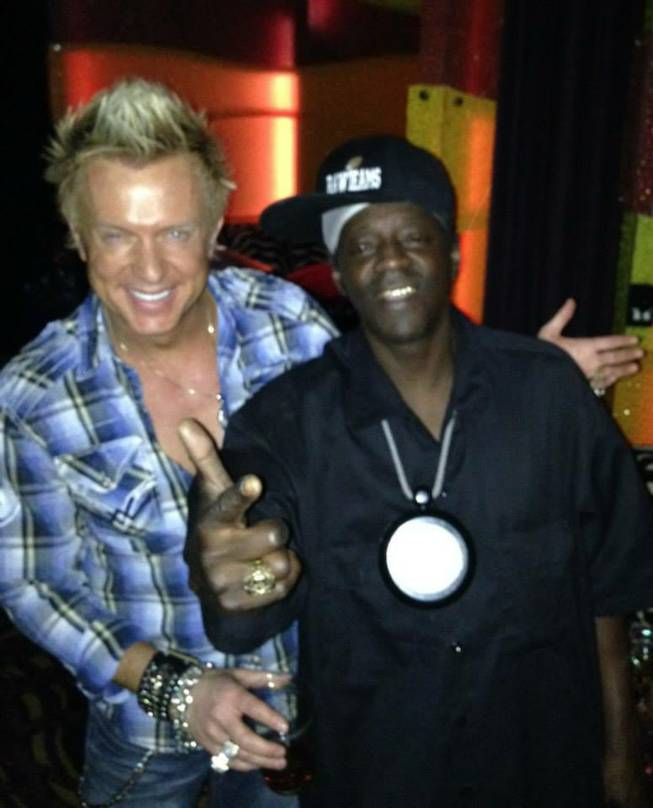 Chris Phillips of Zowie Bowie, left, and Flavor Flav throw it down at Rocks Lounge.