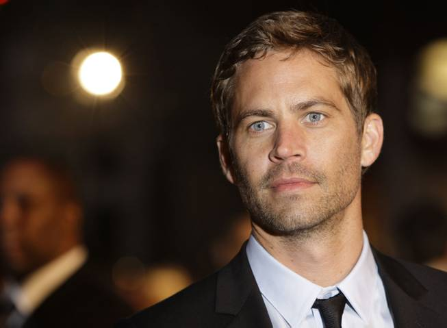 "Paul Walker arrives for the U.K. premiere of ""Fast & Furious"" in London's Leicester Square on Thursday, March 19, 2009."