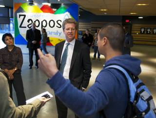Shaun Donovan, secretary of the U.S. Department of Housing and Urban Development, center, begins a tour of downtown Las Vegas by meeting Tony Hsieh at Zappos on Wednesday, Dec. 4, 2013.