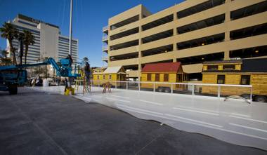 A skating rink at the Golden Spike is under construction Wednesday, Dec. 4, 2013.